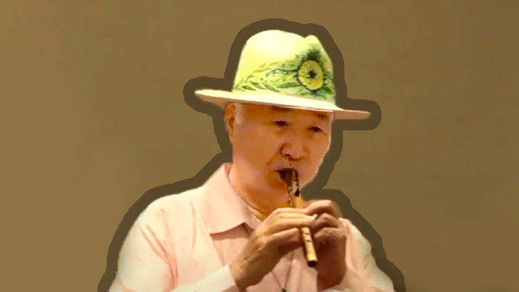 Ilchi Lee playing the flute