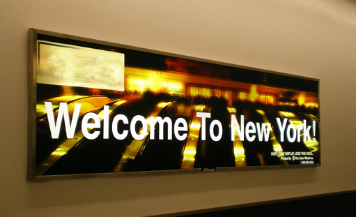 """Sign inside John F. Kennedy Airport in New York reading, """"Welcome to New York."""""""