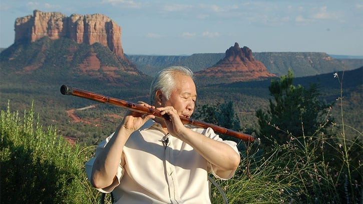 Ilchi Lee playing a flute in Sedona