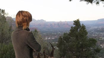 woman looking down into valley in Sedona, AZ
