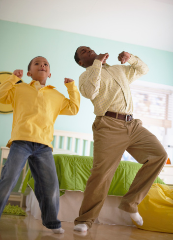 Father and Son Dancing at Home