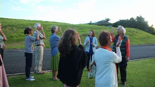 Ilchi Lee guiding meditation outside in New Zealand