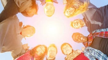 the heads of a circle of people