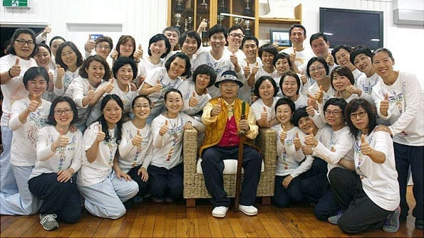 Ilchi Lee in New Zealand with members of a meditation tour from Korea