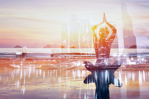 Peace in the brain | a woman meditating in front of a cityscape