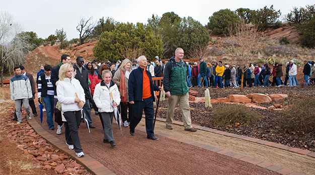 Ilchi Lee walking with students a the Healing Garden at Sedona Mago Retreat