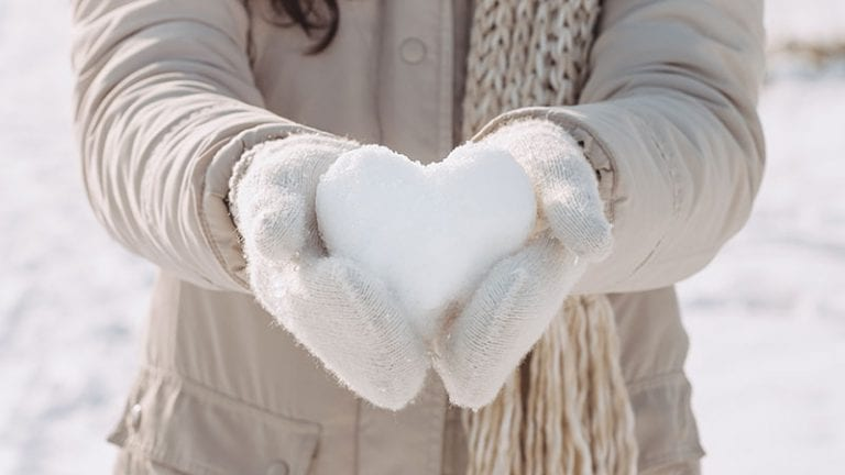 Woman holding a snow heart