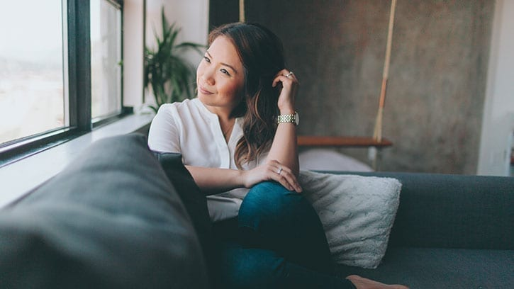 pensive woman on a couch