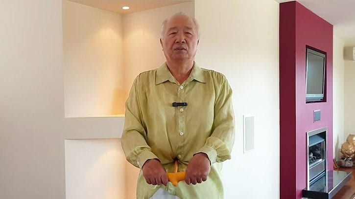 Ilchi Lee doing Belly Button Healing