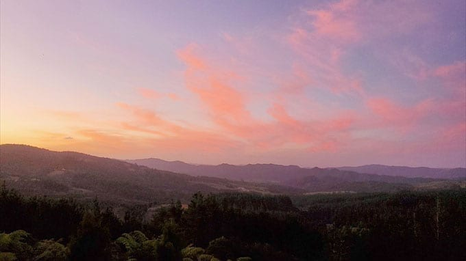 sunrise over small hills in New Zealand