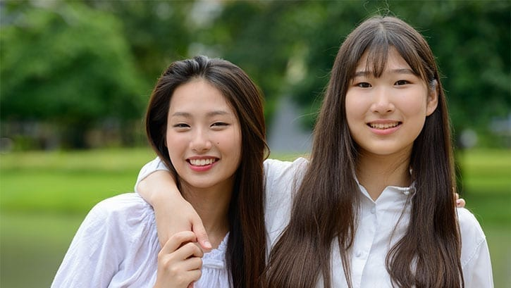Two young Asian female friends