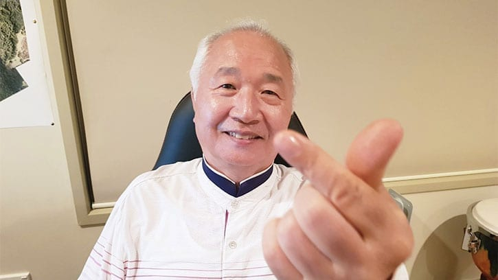 Ilchi Lee giving a finger heart