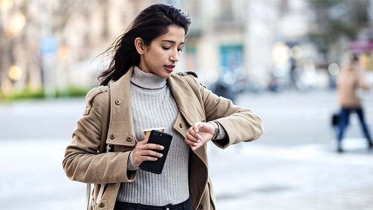 young woman looking at a watch