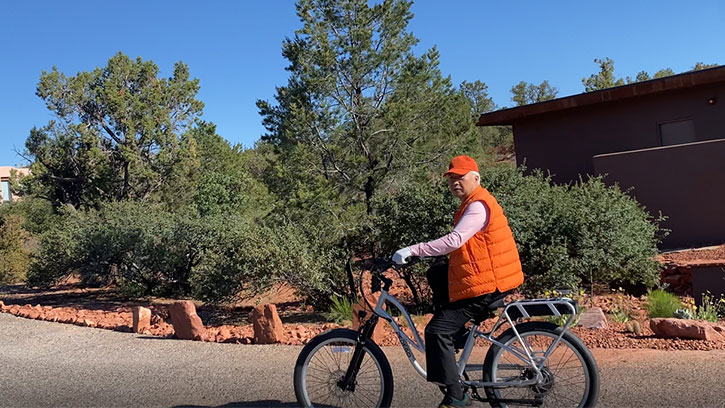 Ilchi Lee riding a bicycle in Sedona