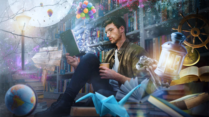 man reading while surrounded by dream objects