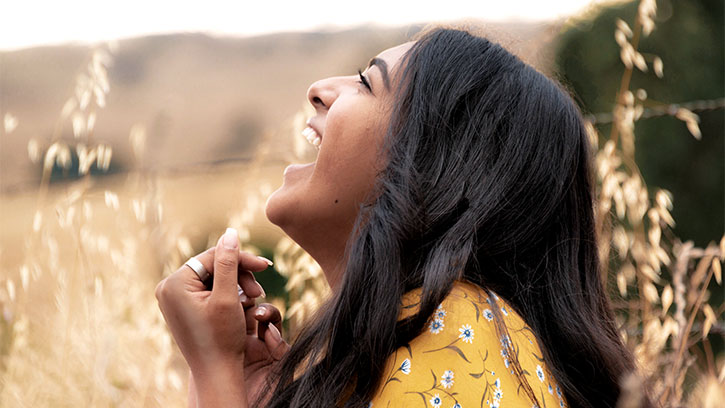 Young Indian woman laughing